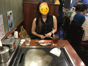 See how excited my cousin is? Okonomiyaki grilling is serious business.